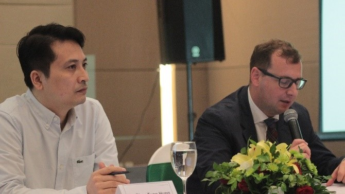 Mr. Pham Tuan Hung and Dr. Axel Neubert on the first day of the workshop.