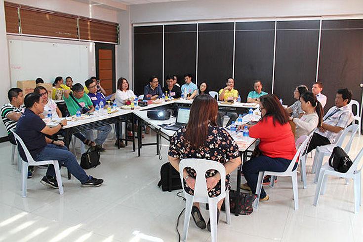 CBD workshop participants discussing in a U-shape table