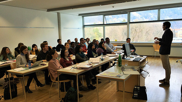 Participants sitting in classroom type setup with the instructor in front of them